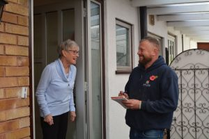 Howard Evans Roofing with a Domestic customer discussing a re roofing project